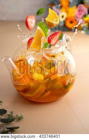Fruit Tea In Glass Teapot With Floating Fruti Slices And Tea Splashes. Levitation, Tea.