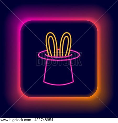 Glowing Neon Line Magician Hat And Rabbit Ears Icon Isolated On Black Background. Magic Trick. Myste