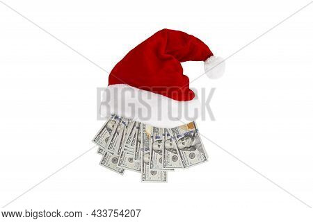 New Year Or Christmas Gift Concept. Money Inside Santa Hat. Christmas Hat Full Of 100 Dollar Bill Is