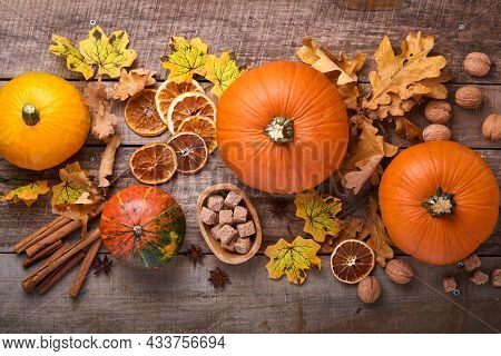 Pumpkin. Autumn Food Background With Cinnamon, Nuts And Seasonal Spices On Rustic Background. Cookin