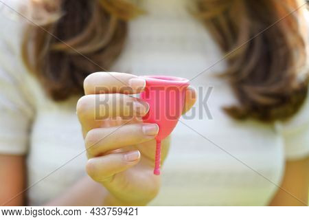 Young Woman Holding Menstrual Cup. Feminine Hygiene Alternative Product Instead Of Tampon During Per