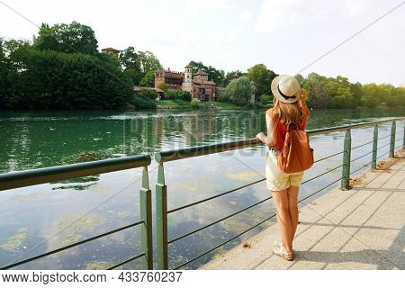 Full Length Of Traveler Girl With Backpack And Hat Looking Middle Ages Castle In The Park. Relaxed Y