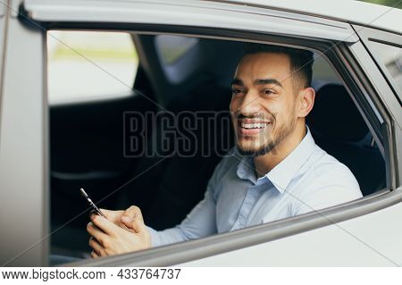 Positive Middle-eastern Businessman Checking Emails While Going To Office