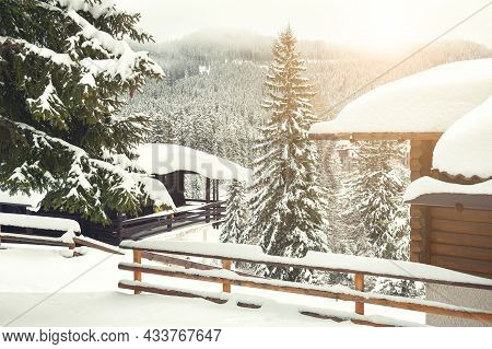 Snow-covered Trees And Houses In Alps Mountains. Carezza Village, Dolomites Alps, Italy. Beautiful W