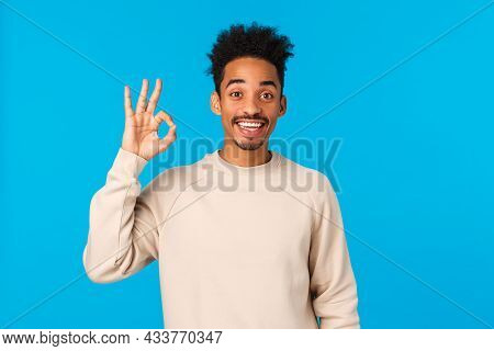 Cheerful Happy Smiling African American With Hipster Haircut, Showing Okay Gesture And Nod In Agreem