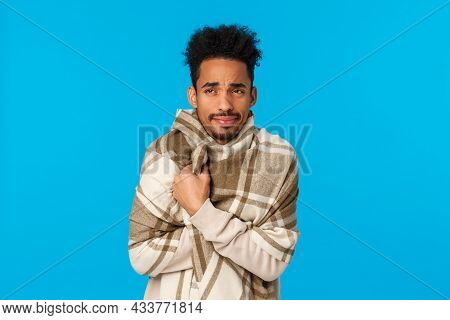Its Freaking Cold Outside. Upset African American Guy Feel Unwell During Winter Holidays, Looking Le