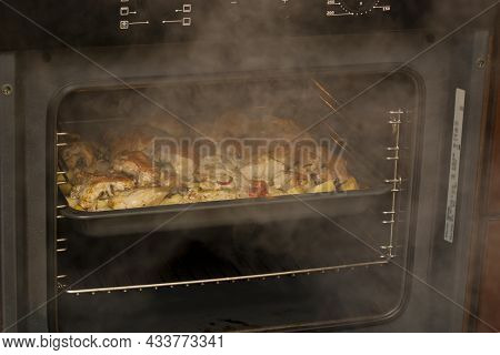 Cooking Chicken Meat With Potatoes. Baking Tray With Chicken, Potatoes, Carrots And Red Pepper Insid