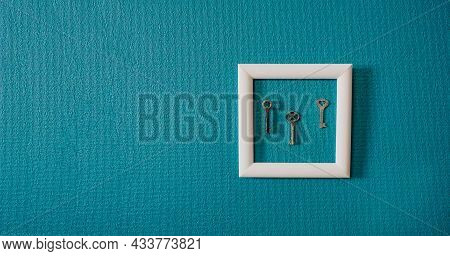 Key In Frame On Blue Wall Backgroung. Key New Home, Homeownership, Keys To The House, Buying Home