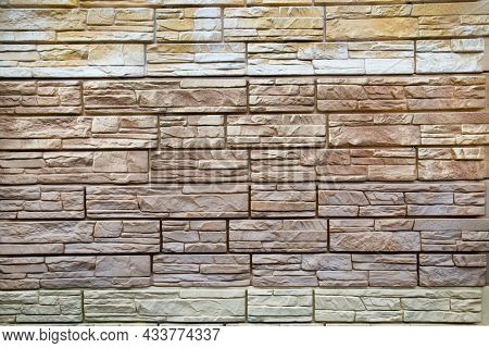 The Background Of The Wall Is Made Of Artificial Stone Of Elongated Irregular Shape In White, Beige