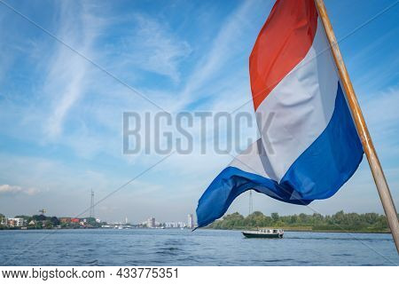 Dutch Flag Blowing In Breeze On Stern Of River Ferry Cruising On New Meuse River, Rotterdam Netherla