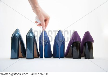 Fashionable Womens Shoes Are In A Row. Womens Hands With A Tape Measure Measure The Height Of The He