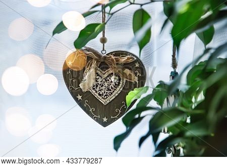 Handmade Vintage Heart-shaped Christmas Toy Hanging On The Window With Organza Curtain. Window Decor