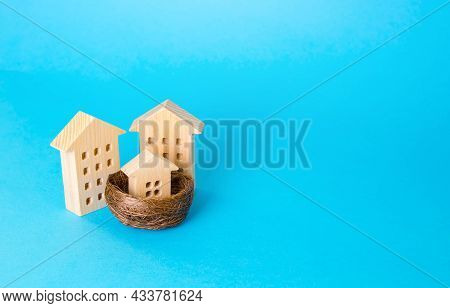 Parents And Child In The Metaphor Of Houses. Investing In Real Estate. Construction, Development. Re