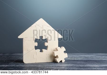 Puzzle House With A Missing Part. Housing Construction, Design And Engineering. Mortgage Loan For Pu
