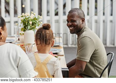Portrait Of Smiling African-american Man Enjoying Dinner With Family Outdoors At Terrace, Copy Space