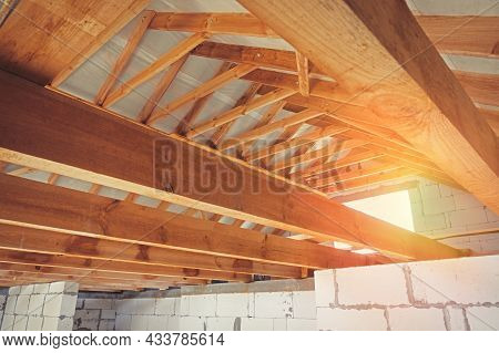 Construction Of A Wooden Roof From Beams And Roofs. New Home Construction.