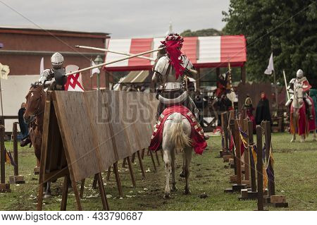 Two Knights Compete During The Reenactment Of A Medieval Knightly Tournament, A Knightly Horse Duel,