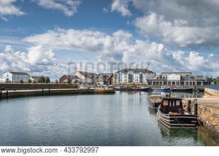 Sailboats And Fishing Boats Moored In Small, Beautiful Marina In Carrickfergus Town, Northern Irelan