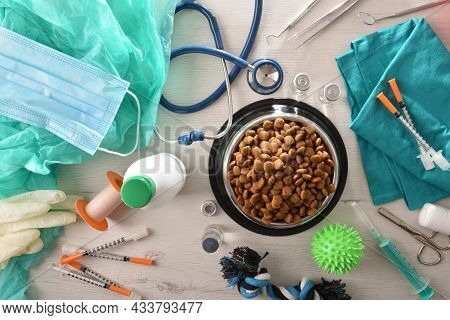 Background With Table With Supply For Veterinarians With Medical Supplies And Dog Accessories And Wi