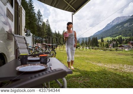 Family vacation travel, holiday trip in motorhome, Caravan car Vacation VR. Beautiful Nature Italy natural landscape Alps.