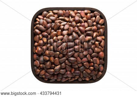 Shelled Pine Nuts In Wooden Bowl Closeup. Vegetarian Food, Pine Nuts Isolated On White.