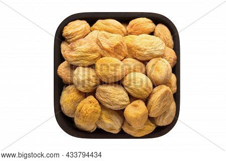 Dried Apricots With Stone In Wooden Bowl Closeup. Vegetarian Food, Apricot Isolated On White.