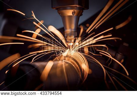 CNC Laser cutting of metal, modern industrial technology Making Industrial Details. The laser optics and CNC (computer numerical control) are used to direct the material or the laser beam generated.