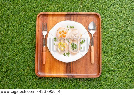 Coconut-rice Pancakes In White Plate On Wooden Tray With Green Background. Made From Coconut Cream W
