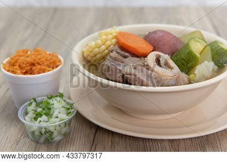 Hearty Bowl Of Caldo De Res Mexican Beef Stew Hot From The Stove And Served With Rice And Pico De Ga