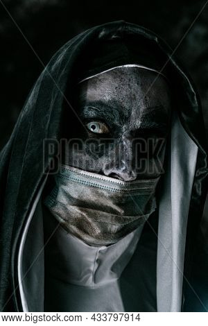 closeup of an evil nun, wearing a typical black and white habit, and a dirty disposable face mask