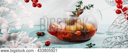 Banner With Immunity Boosting Drink. Winter Tea With Cranberries, Orange And In Glass Teapot