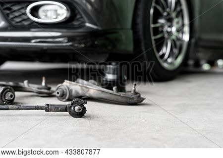 Old Ball Joint Of Steering Rack Arm Car And Steering Spare Parts On The Floor Of Garage Repair Car C