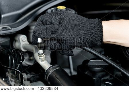 Technician Add Air Conditioning Liquid At Nozzle Pipe In The Car's Air Conditioning System