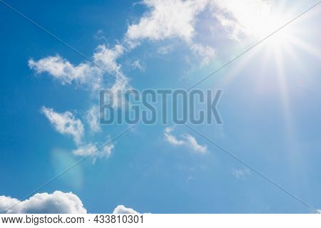 Shining Sun Through The Clouds Blue Sky,cloud.solar Lens Flare. Copy Space.natural Lens Flare.sunray