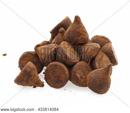 Chocolate Truffles With Sweet Cream Inside On The White Background