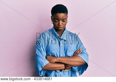 Young african american woman with arms crossed gesture depressed and worry for distress, crying angry and afraid. sad expression.