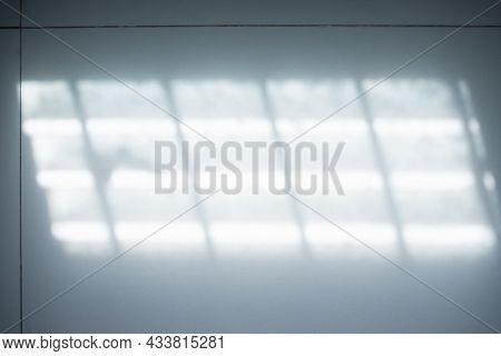 Blur Abstract Light From Window Background. New Design Backdrop Bright Light Shapes Display On Iled
