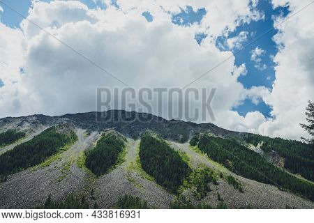 Awesome Scenery With Shadow Of Big Cloud On High Mountain Top. Huge White Cloud In Blue Sky Over Gia