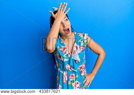 Young latin woman wearing casual clothes surprised with hand on head for mistake, remember error. forgot, bad memory concept.