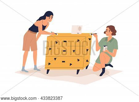 Women Decorating And Painting Furniture. Couple Renewing And Restoring Cabinet With Paint And Brushe