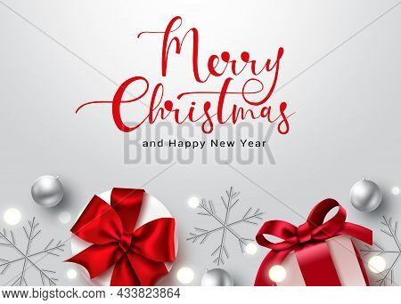 Merry Christmas Text Vector Background Design. Merry Christmas Typography Text With Gifts And Snowfl