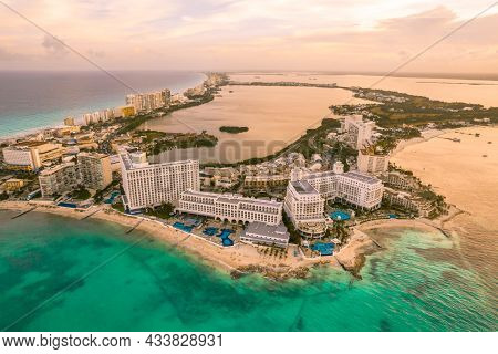 Aerial Panoramic View Of Cancun Beach And City Hotel Zone In Mexico At Sunset. Caribbean Coast Lands
