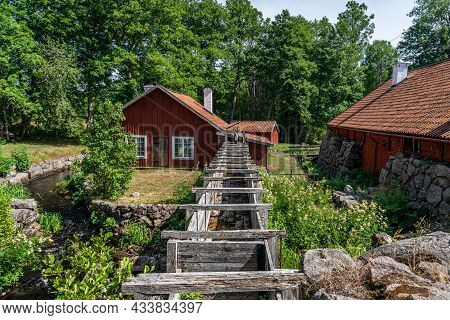 Vira Bruk, Sweden - July 5, 2021: Outdoor Summer View Of Old Red Traditional Wooden Buildings. Open-