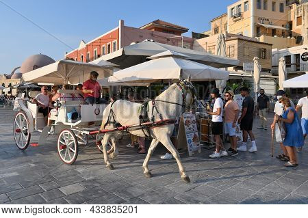 Chania, July 22: Horse Carriage In The Center Of The City Of Chania. Lots Of Tourists In The Summer