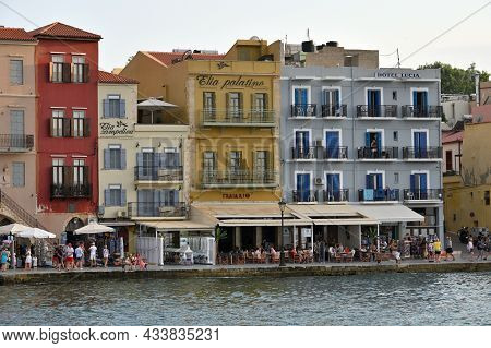 Chania - July 22: City Buildings At Harbor Of Chania, Greece On July 22, 2021. Chania Is One Of The