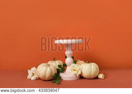 Autumn Still Life Concept With Podium Or Pedestal For Product Display,white Pumpkins And Flowers On