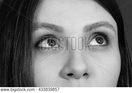 Achromatic Close-up Portrait With Above Part Of Face Of Beautiful Woman. Black Hair And Eyes Of Almo