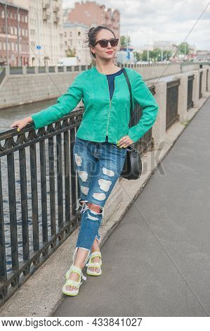 Beautiful Stylish Young Woman Posing In The City