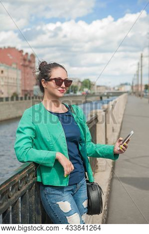 Beautiful Stylish Woman Posing In The City With Mobile Phone
