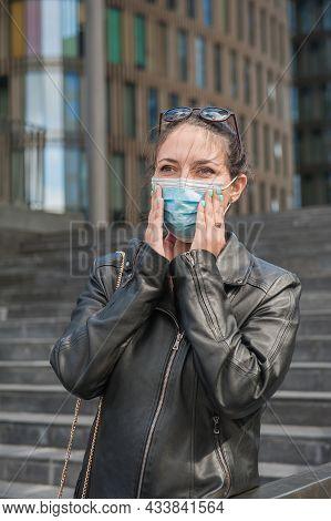 Beautiful Business Woman Wearing Medical Mask Standing Near Modern Building